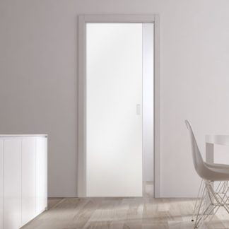 Single glass Eclisse pocket door used in a kitchen and dining room